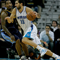Dec 18, 2009; New Orleans, LA, USA;  New Orleans Hornets forward Peja Stojakovic (16) drives past Denver Nuggets guard J.R. Smith (5) during the second half at the New Orleans Arena. The Hornets defeated the Nuggets 98-92. Mandatory Credit: Derick E. Hingle-US PRESSWIRE