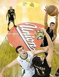 Edin Bavcic (9) of Olimpija vs Dimitrios Mavroeidis  of Maroussi at Euroleague basketball match of Group C between KK Union Olimpija, Ljubljana and Maroussi B.C., Athens, on October 29, 2009, in Arena Tivoli, Ljubljana, Slovenia. Olimpija lost 75:81.  (Photo by Vid Ponikvar / Sportida)