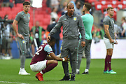 Aston Villa striker Gabby Agbonlahor (11) consoles Aston Villa striker Jonathan Kodjia (22) at the end of the EFL Sky Bet Championship play-off final match between Fulham and Aston Villa at Wembley Stadium, London, England on 26 May 2018. Picture by Dennis Goodwin.