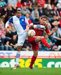 Bristol City's Steven Davies battles for the high ball with Blackburn Rovers' Martin Olsson - Photo mandatory by-line: Joe Meredith/Josephmeredith.com  - Tel: Mobile:07966 386802 15/09/2012 - Bristol City v Blackburn Rovers - SPORT - FOOTBALL - Championship -  Bristol  - Ashton Gate Stadium -