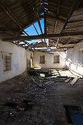 Wooden beams in derelict abandoned house ruin in ancient village of Old Perithia - Palea Peritheia, Corfu, Greece