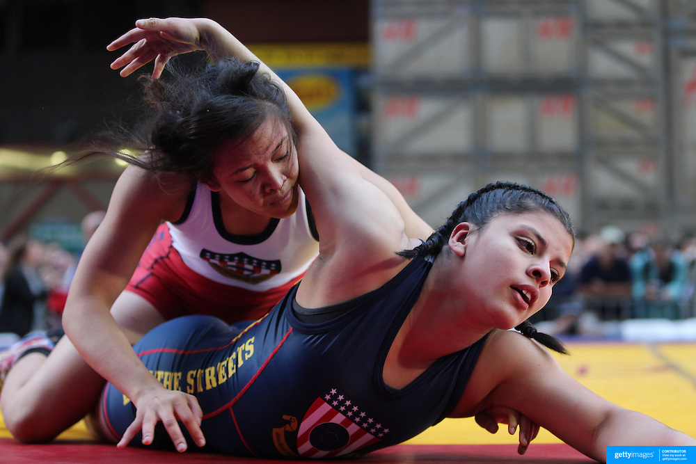 Girl wrestlers Samantha Oye-Gonzalez, (top), New York City, in action against  Nazareth Saavedra, New Jersey, during the 'Beat The Streets' USA Vs The World, International Exhibition Wrestling in Times Square. New York, USA. 7th May 2014. Photo Tim Clayton
