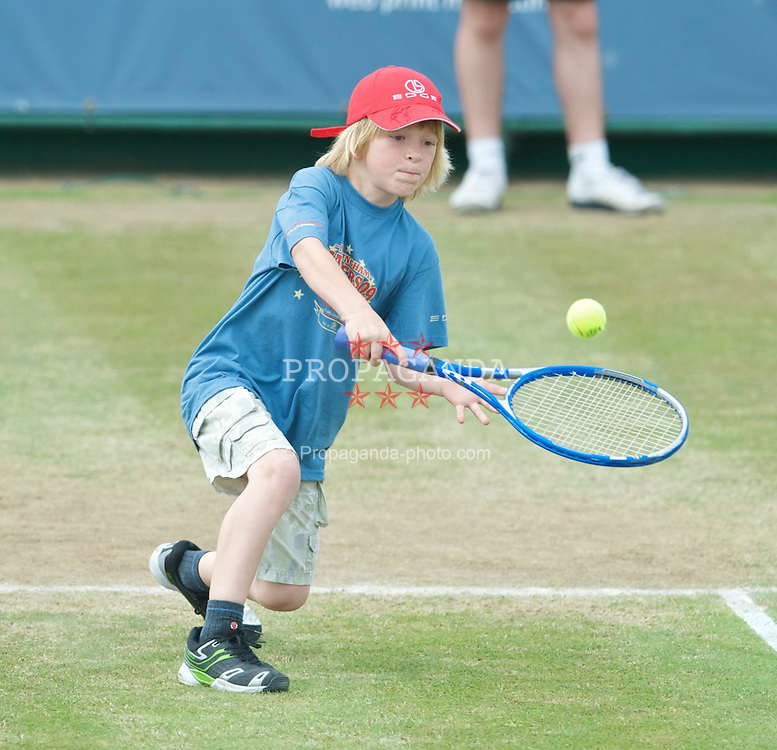 NOTTINGHAM, ENGLAND - Sunday, June 14, 2009: A young spectators plays for Greg Rusedski (GBR) on finals day of the Tradition Nottingham Masters tennis event at the Nottingham Tennis Centre. (Pic by David Rawcliffe/Propaganda)