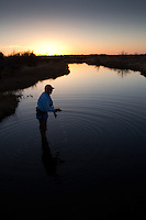 FLY ANGLER FISHING A RIVER IN FAR WEST TEXAS PEASE RIVER IN TEXAS