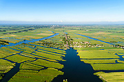 Nederland, Noord-Holland, Gemeente Wormerland, 13-06-2017; Wijdewormer ook (De) Wormer. Onderdeel van polder en droogmakerij Polder Wormer, Jisp en Nek. Foto richting dorp Jisp. De verkaveling in het gebied is het resultaat van veenontginning<br /> Polder in province North-Holland (above Amsterdam) with villages. The division in plots in the area is the result of peat extraction.<br /> <br /> luchtfoto (toeslag op standard tarieven);<br /> aerial photo (additional fee required);<br /> copyright foto/photo Siebe Swart