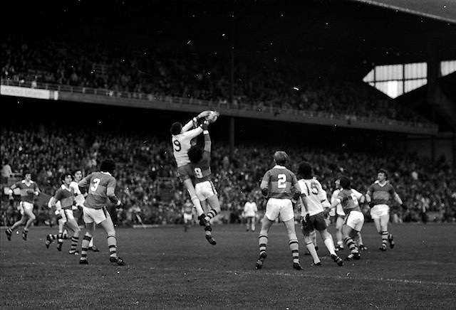 Tyrone and Kerry jump high for the ball surrounded by players seeing who wins possession during the All Ireland Minor Gaelic Football Final, Tyrone v Kerry in Croke Park on the 28th September 1975.