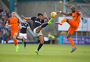 August 9th 2017, Dens Park, Dundee, Scotland; Scottish League Cup Second Round; Dundee versus Dundee United; Dundee's Faissal El Bakhtaoui and Dundee United's William Edjenguele battle for a high ball