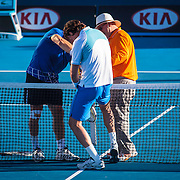 Pat Cash and Linesman check the net height, Goran Ivanisovich measures something else, 2013 Australian Open Tennis, Melbourne, Victoria