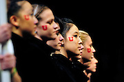 University of Utah sophomore Fumina Kobayashi, center, keeps an eye on her competitors during the national anthem at the 2011 Women's NCAA Gymnastics Championship Team Finals on April 16, in Cleveland, OH. (photo/Jason Miller)