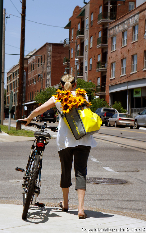 A shopper heads home after a successful morning shopping at the downtown Farmers Market at the train station in Memphis, Tennessee. Scenes from downtown Memphis, Tennessee.