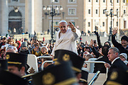 Pope Francis arrives for his weekly general audience at St Peter's square on November 22, 2017.