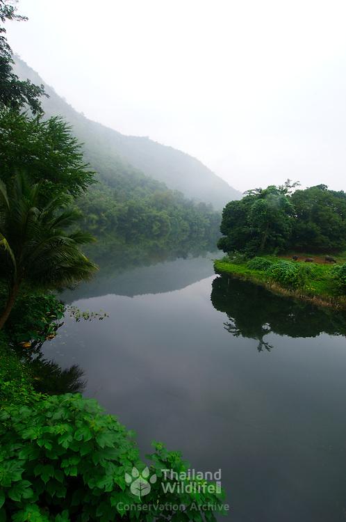 Rural scene on a rainy morning at the River Kwai Yai in Kanchanaburi, Thailand.