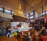 Cambodian buddhists presenting offerings during the Khmer New Year celebrations in the Great Pagoda of the Bois de Vincennes, in the 12th arrondissement of Paris, France, photographed on 14th April 2019. This is the largest buddha statue in Europe at 9m high, and is covered in gold leaf. Cambodians celebrate the entrance of the sun to the constellation of the ram, marking the beginning of the Buddhist year 2563. Khmer New Year or Chaul Chnam Thmey marks the end of the dry season and Cambodians celebrate by bringing offerings to temples or wats. Picture by Manuel Cohen