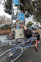 Indoor cycling facility coordinator Andrew Alfieri pumps up his bicycle tire in Concord, CA.