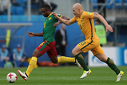 June 22, 2017 - Saint Petersburg, Russia - Sebastien Siani (L) of the Cameroon national football team and Aaron Mooy of the Australia national football team vie for the ball during the 2017 FIFA Confederations Cup match, first stage - Group B between Cameroon and Australia at Saint Petersburg Stadium on June 22, 2017 in St. Petersburg, Russia. (Credit Image: © Igor Russak/NurPhoto via ZUMA Press)