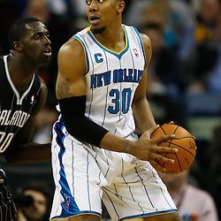 January 12, 2011; New Orleans, LA, USA; New Orleans Hornets power forward David West (30) is guarded by Orlando Magic power forward Brandon Bass (30) during the second half at the New Orleans Arena. The Hornets defeated the Magic 92-89.  Mandatory Credit: Derick E. Hingle