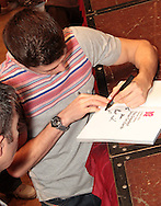 Picture by Richard Gould/Focus Images Ltd +44 7855 403186<br /> 22/06/2013<br /> Luke Cambell signs a fans book pictured during a press conference at Hull City Hall.
