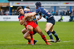 Bristol Rugby Inside Centre Ben Mosses is tackled by Bedford Blues Winger Pat Tapley and Fly-Half Myles Dorrian - Mandatory byline: Rogan Thomson/JMP - 19/12/2015 - RUGBY UNION - Goldington Road - Bedford, England - Bedford Blues v Bristol Rugby - B&I Cup.