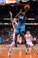 Jan 6, 2016; Phoenix, AZ, USA; Charlotte Hornets forward P.J. Hairston (19) goes up with the basketball against Phoenix Suns forward Jon Leuer (30) in the first half at Talking Stick Resort Arena. The Phoenix Suns defeated the Charlotte Hornets 111-102. Mandatory Credit: Jennifer Stewart-USA TODAY Sports