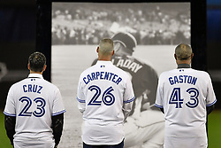 March 29, 2018 - Toronto, ON, U.S. - TORONTO, ON - MARCH 29: Blue Jays past players Jose Cruz Jr. (43) Chris Carpenter (26) and Manager Cito Gaston (43) during a ceremony honoring the late pitcher Roy Halladay. The team retired Halladay's No. 32 on opening day before the MLB season game between the New York Yankees and the Toronto Blue Jays at Rogers Centre in Toronto, ON., Canada March 29, 2018. Jays players will also wear a no. 32 patch on their jerseys throughout the season in tribute to Halladay. Halladay, nicknamed 'Doc' who spent 12 seasons as a pitcher with the Jays, died in November 2017 when his personal plane crashed into the Gulf of Mexico near Tampa. He was 40 years old. Halladay joins Robero Alomar (no. 12) as the only 2 players in Jays history to have their jersey numbers retired. (Photo by Jeff Chevrier/Icon Sportswire) (Credit Image: © Jeff Chevrier/Icon SMI via ZUMA Press)
