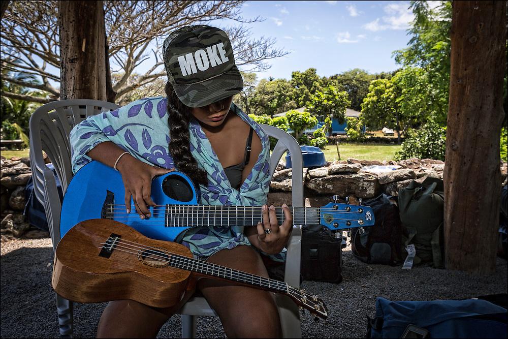 Karina Jacany plays guitar at the Keawanui Fishpond base camp.