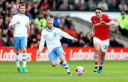 Callum Elder of Barnsley goes past Barry Bannan of Sheffield Wednesday - Mandatory by-line: Robbie Stephenson/JMP - 01/04/2017 - FOOTBALL - Oakwell Stadium - Barnsley, England - Barnsley v Sheffield Wednesday - Sky Bet Championship