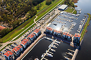 Nederland, Flevoland, Zeewolde, 01-05-2013;<br /> Vakantiepark De Eemhof van Center Parcs en jachthaven met plezierjachten en zeilboten.<br /> Holiday park Center Parcs and marina with yachts and sailboats.<br /> luchtfoto (toeslag op standard tarieven)<br /> aerial photo (additional fee required)<br /> copyright foto/photo Siebe Swart