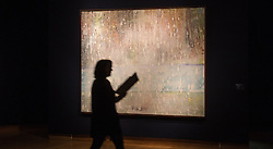 Christie's, London, March 3rd 2017. PICTURED: A woman walks past Peter Doig's 'Coburg 3+1 More', painted in 1994 which is estimated to fetch between £8-12 million. <br /> Fine art auctioneers Christies hold a press preview for their Post-War and Contemporary Art auctions to be held on March 7th and 8th.