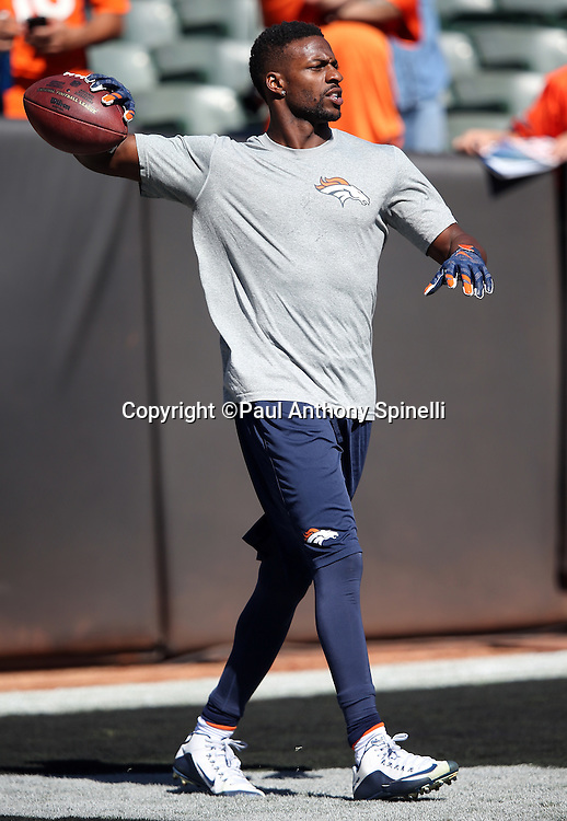 Denver Broncos wide receiver Emmanuel Sanders (10) throws a pass while warming up before the 2015 NFL week 5 regular season football game against the Oakland Raiders on Sunday, Oct. 11, 2015 in Oakland, Calif. The Broncos won the game 16-10. (©Paul Anthony Spinelli)