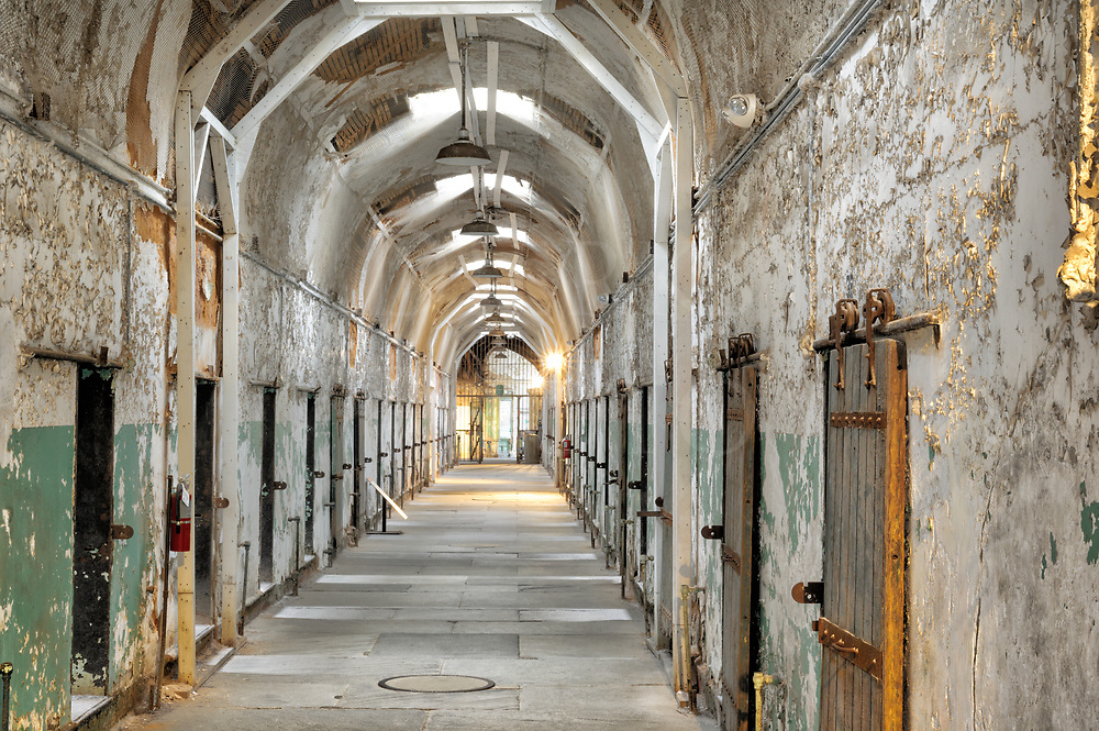 Prison cellblock in full length view at the Eastern State Penitentiary, Philadelphia, PA, USA.