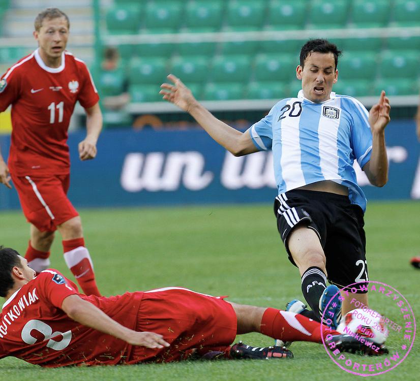 WARSZAWA 05/06/2011.FOOTBALL.INTERNATIONAL FRIENDLY.POLAND v ARGENTINA.GRZEGORZ WOJTKOWIAK /POL/ AND ALEJANDRO CABRAL /ARG/.PHOTO BY: PIOTR HAWALEJ / WROFOTO