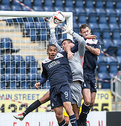 Falkirk's Phil Roberts and David McCracken with Queen of the South's keeper Calum Antell.<br /> Falkirk 2 v 1 Queen of the South, Scottish Championship 5/10/2013, played at The Falkirk Stadium.<br /> &copy;Michael Schofield.