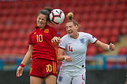 Nerea Eizaguirre (#10) of Spain wins the header against Aimee Palmer (#4) of England during the UEFA Women's U19 European Championship match between England Women and Spain at Forthbank Stadium, Stirling, Scotland on 19 July 2019.