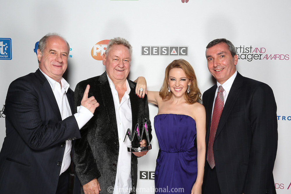 Kylie Minogue presented the prestigious Peter Grant Award to her long-time manager Terry Blamey at the Artist and Manager Awards 2012, held at The Troxy, London. Tuesday, Nov.27, 2012 (Photo/John Marshall JME)