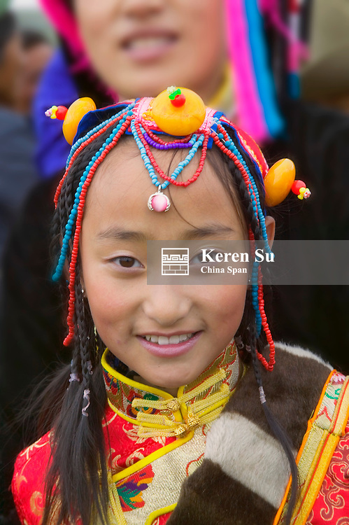 Tibetan people in traditional costume at Horse Race Festival, Litang, Sichuan-Tibet, China