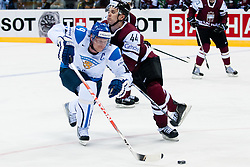 Mikko Koivu of Finland vs Oskars Cibulskis of Latvia during ice-hockey match between Latvia and Finland of Group D of IIHF 2011 World Championship Slovakia, on May 2, 2011 in Orange Arena, Bratislava, Slovakia. (Photo by Matic Klansek Velej / Sportida)