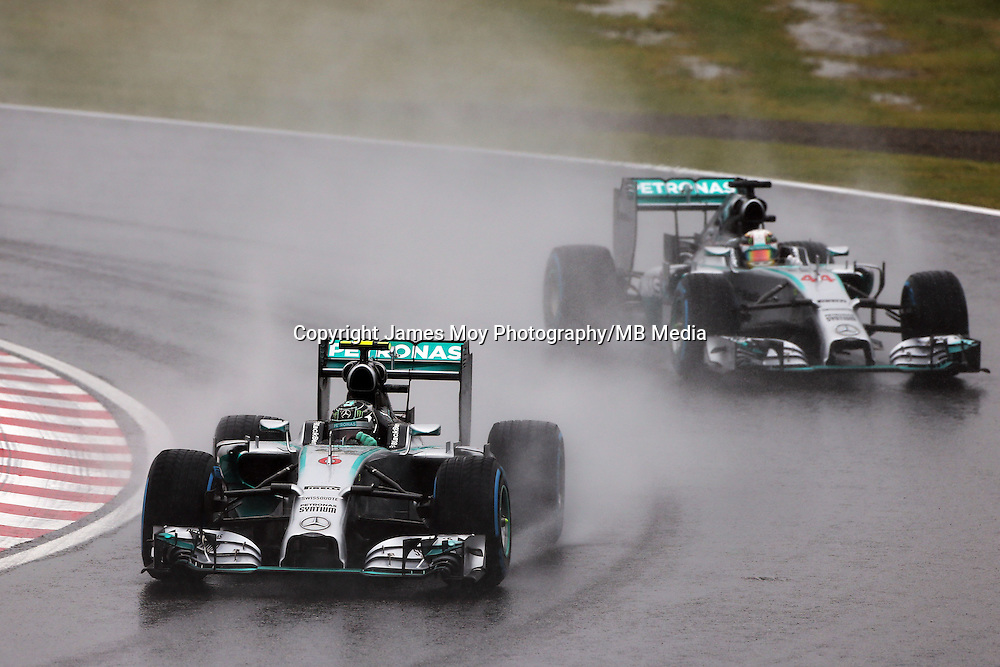 Nico Rosberg (GER) Mercedes AMG F1 W05 leads team mate Lewis Hamilton (GBR) Mercedes AMG F1 W05.<br /> Japanese Grand Prix, Sunday 5th October 2014. Suzuka, Japan.