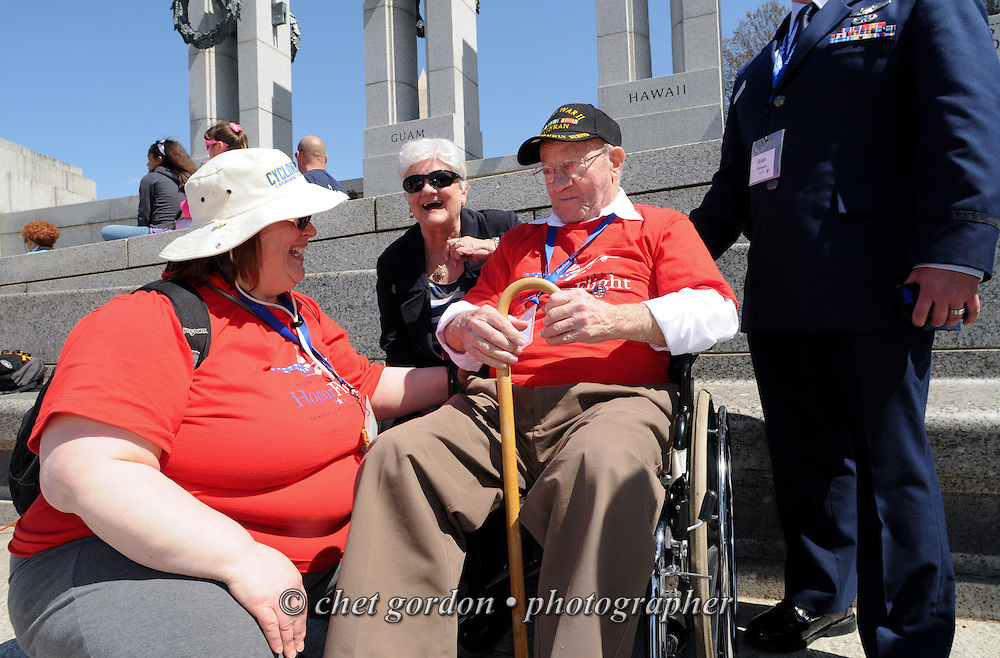 WWII Veterans and their escorts onboard the Hudson Valley Honor Flight at the World War II Memorial in Washington, DC on Saturday, April 11, 2015. Nearly 100 Veterans from the Orange County (NY) region toured the WWII, Korean, Vietnam, and USMC War Memorials, as well as Arlington National Cemetery. Hudson Valley Honor Flight is a chapter of the Honor Flight Network, which provides free flights for WWII Veterans and tours of the WWII Memorial constructed in their honor, and other sites in the nation's capital.  © Chet Gordon for Hudson Valley Honor Flight