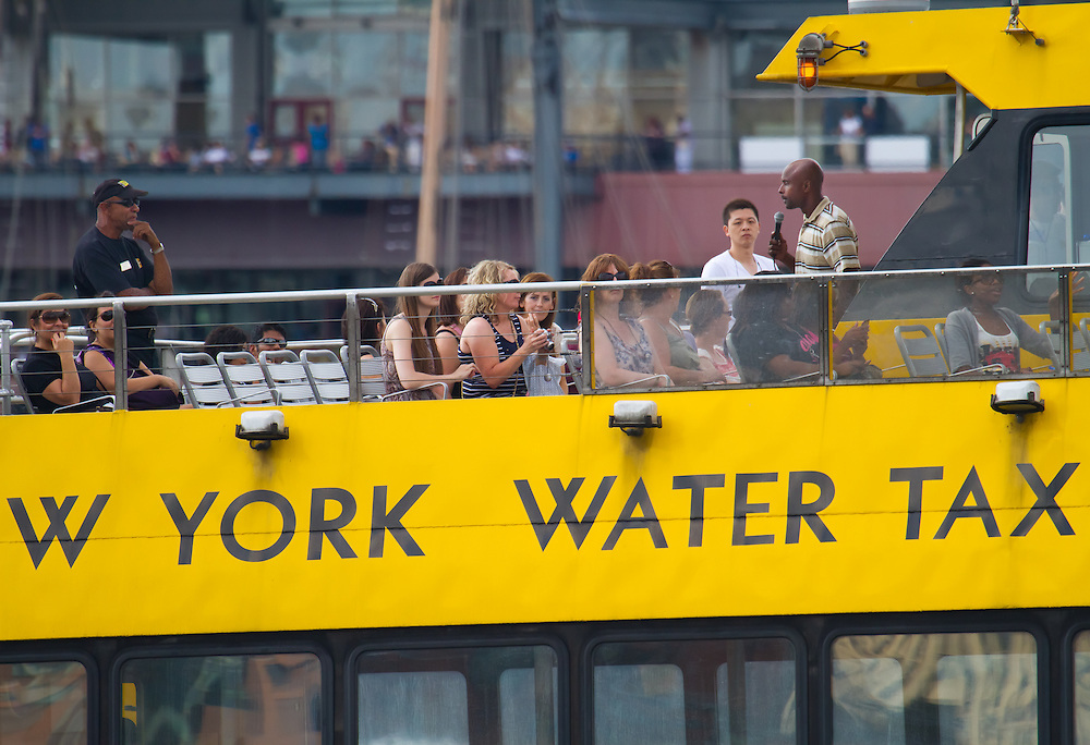 Water Taxi passengers get some tour guidance.