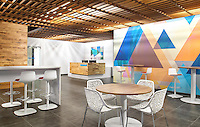 My commercial architecture clients designed a visually high-impact lobby and break space for the Florida offices of Jackson Hewitt.