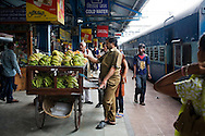 Passengers disembark to buy mousumbi and bananas during a 15 minute stop at Nagpur station, Maharashtra. Nagpur station is known for its oranges and grapes but both was out of season at this time...Train passengers on the Himsagar Express 6318 going from Jammu Tawi station to Kanyakumari on 8th July 2009.. .6318 / Himsagar Express, India's longest single train journey, spanning 3720 kms, going from the mountains (Hima) to the seas (Sagar), from Jammu and Kashmir state of the Indian Himalayas to Kanyakumari, which is the southern most tip of India...Photo by Suzanne Lee / for The National