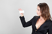 Woman in black business suit holds a blank business card Model released