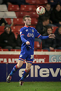 Cameron Dummigan (on loan from Burnley) (Oldham Atheltic) jumps to chest the ball and bring it under control during the Sky Bet League 1 match between Barnsley and Oldham Athletic at Oakwell, Barnsley, England on 12 April 2016. Photo by Mark P Doherty.