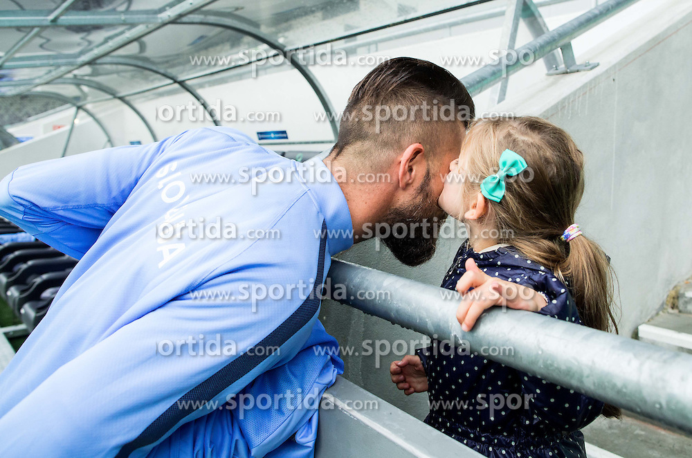 Bostjan Cesar with young girl kissing him during practice session of Slovenian National Football team two days before Euro 2016 Qualifying game between Slovenia and Lithuania, on October 7, 2015 in SRC Stozice, Ljubljana Slovenia. Photo by Vid Ponikvar / Sportida