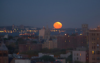 moon setting over Staten Island