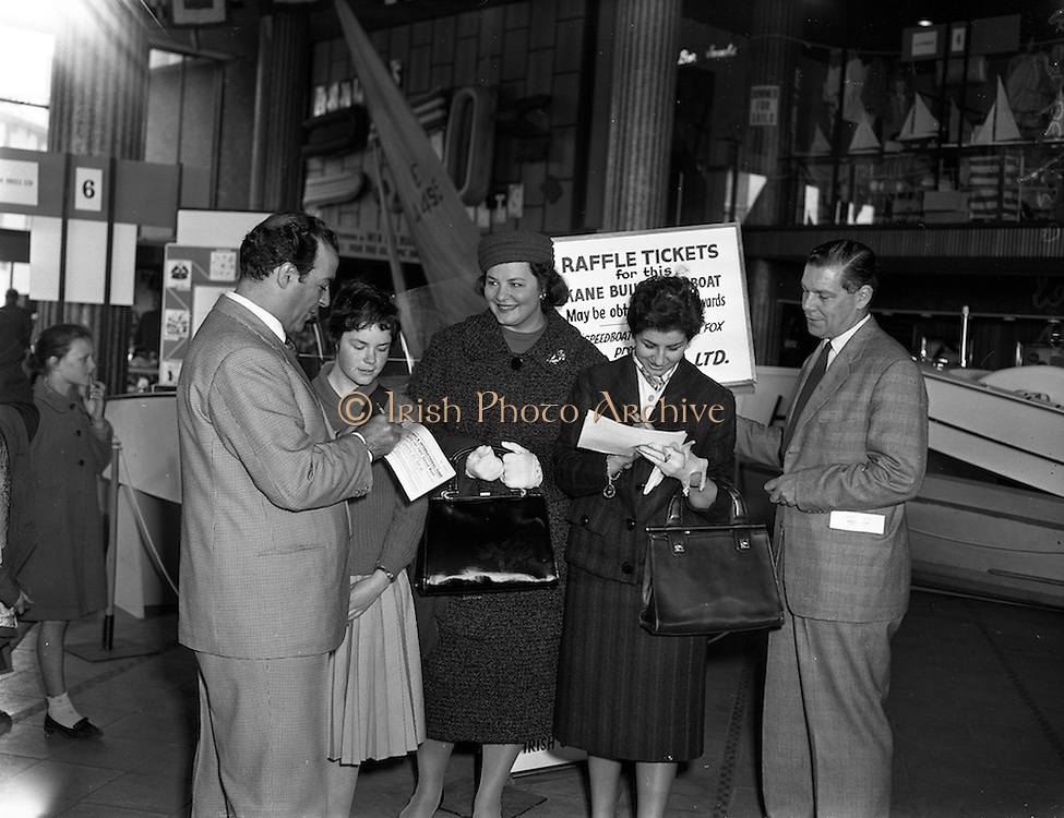 23/04/1960<br /> 04/23/1960<br /> 23 April 1960<br /> Italian Opera Stars at the Dublin Boat Show. Italian Opera Stars who were due to appear in the Dublin Festival of Italian Opera visited the Boat Show at Busaras, Dublin. Picture shows Paolo Silveri (left) Impressario, purchasing a raffle ticket for the motor-boat presented by Irish Shell to the Irish Dingy Association, from Pauline Walker. In the picture are (l-r): Paolo Silveri; Pauline Walker, Irish Dingy Association; Lucilla Udovich, Soprano; Aureliana Beltrami, Soprano and A.G. Simon, Sales Manager Irish Shell Ltd.