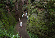 The Ethiopia Highlands are renown for their unique, ancient form of Christianity and magnificent churches carved into the volcanic rock like the entrance of the Tomb of Adam in Lalibela, where workshipers enter a corridor sliced into the mountain itself for an open-air Sunday worship service.  Ethiopian Highlands.