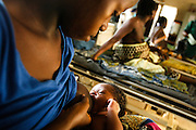 Fatimata S. Koroma, 18, breastfeeds her newborn child Hendry Jalloh, 14 days, in the maternity ward of the Magburaka government hospital in the town of Magburaka, Sierra Leone on Monday March 15, 2010.