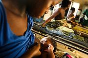 Fatimata S. Koroma, 18, breastfeeds her newborn child Hendry Jalloh, 14 days, in the maternity ward of the Magburaka government hospital in the town of Magburaka, Sierra Leone on Monday March 15, 2010.