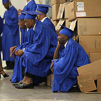 Jartavin Morris finds whatever seat he can as he waits backstage at the BancorpSouth Areana for Friday's THS graduation.